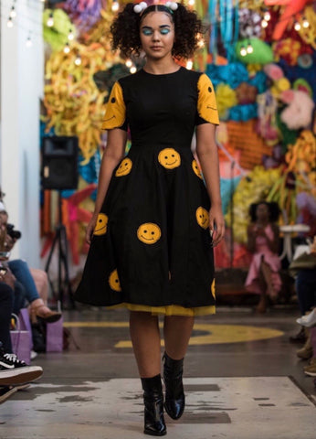 "Black dress with smiley faces from ""SODA"" because collection"