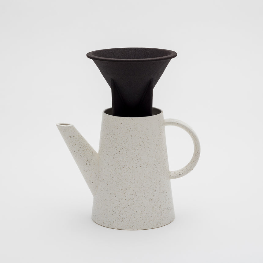 Porcelain filterless coffee dripper designed by Big Game for Arita 2016. Black, porous rock dripper with fins. Handmade in Arita, Japan. Contemporary ceramics.