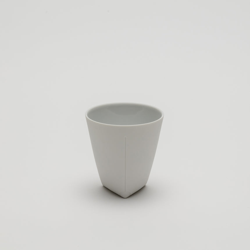 White ceramic coffee cup designed by Christian Haas in Arita, Japan. High quality porcelain. Matte finish.