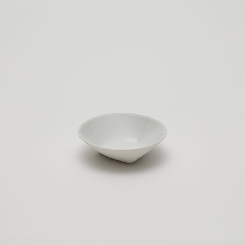 Porcelain espresso saucer or small bowl designed by Christian Haas for Arita 2016. Handemade in Japan. Glazed interior, matte white exterior. Thin profile, contemporary ceramics.