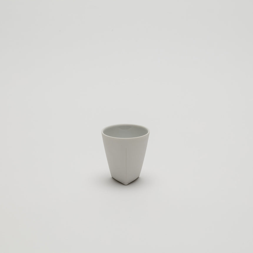 White porcelain espresso cup designed by Christian Haas for Arita 2016. Handmade in Japan. Unglazed exterior, glazed interior in multiple colours. Contemporary ceramics, thin profile.