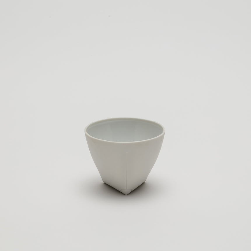 White porcelain coffee cup designed by Christian Haas for Arita 2016. White glazed interior, matte white exterior with a triangular base and circular lip. Thin walled contemporary ceramics.