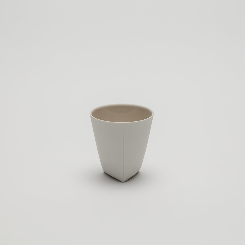 Pink porcelain coffee cup designed by Christian Haas, made in Arita, Japan. High quality, contemporary ceramics.