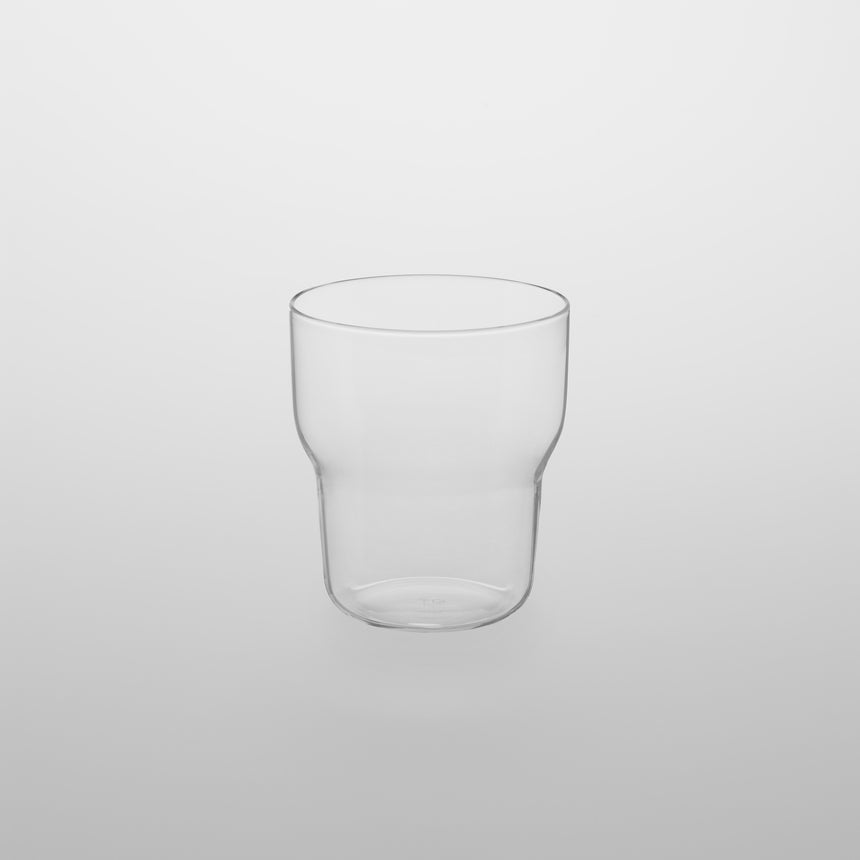 Stackable glass tumbler Designed by Naoto Fukasawa for TG Taiwan Glass. Clear borosilicate on grey background.