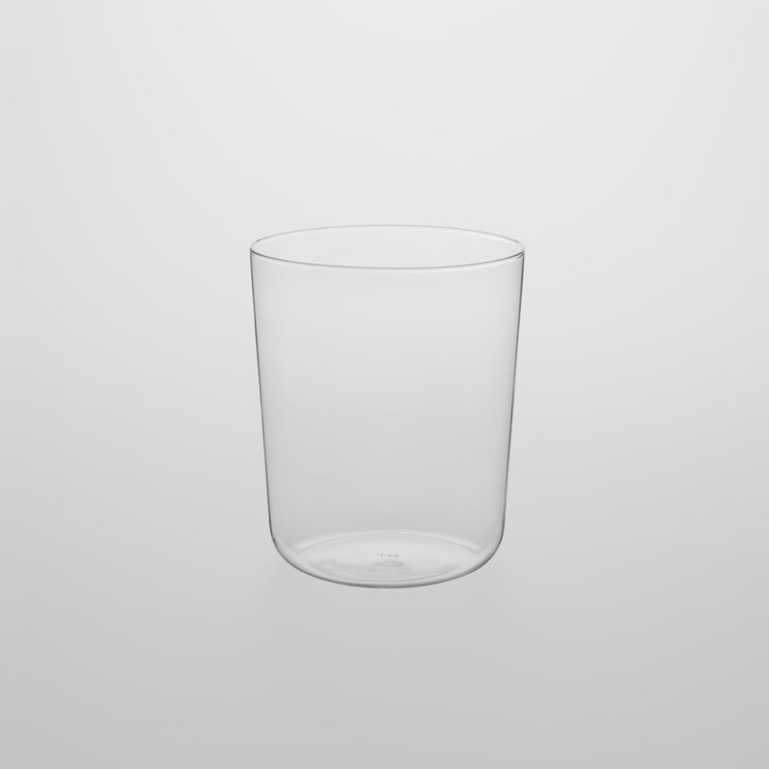 Medium, thin walled glass Designed by Naoto Fukasawa for TG Taiwan Glass. Clear borosilicate on grey background.