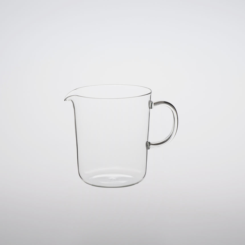 Lipped glass mug lipped glass server design by Naoto Fukasawa borosilicate glass on grey background