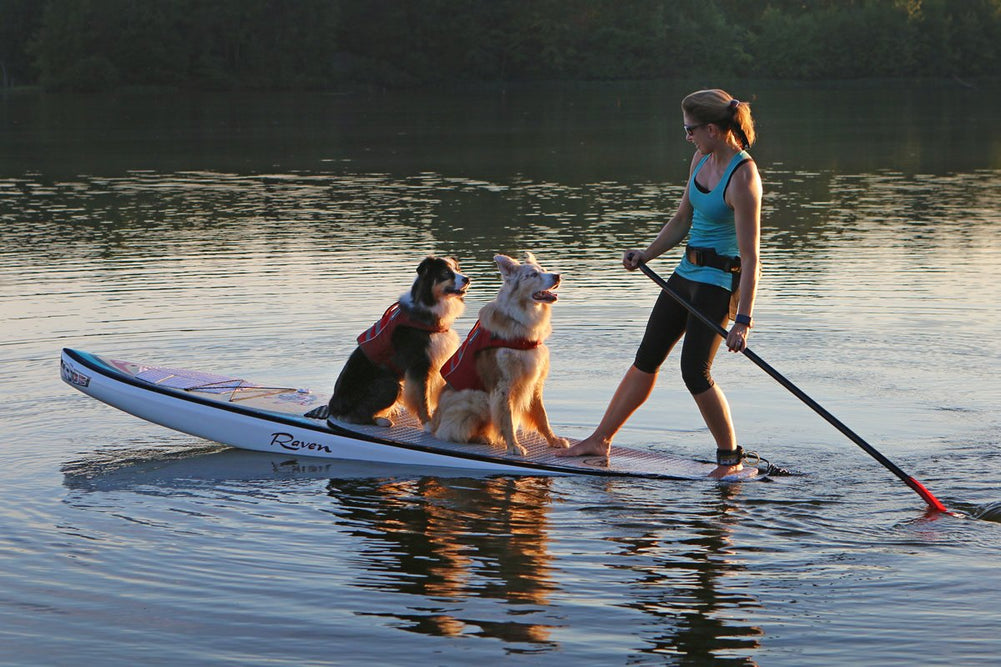 Ambassador Maria Schultz Paddleboard Instructor Poses with Riley and Kona in Ruffwear Float Coats