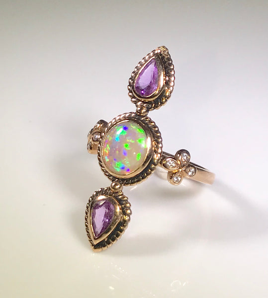 Opal Cocktail Ring set in 18k Rose Gold with Purple Sapphires