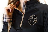 Detail of Young Woman Wearing American Saddlebred Museum Sun Shirt Black with Tan Plaid on Collar and Cuffs, Tan on Sleeve Vents and Zipper, and Horse Logo on Upper Left Chest in Tan