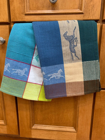Plaid Horse Kitchen Towels Running Horses Blue Green and Blue Beige Hanging Over Natural Wood Kitchen Cabinet Door