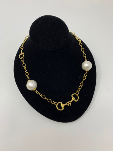 Gold Colored Chain Neclace with Snaffle Bits Going Around and a Cotton Pearl on Each Side
