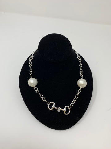 Silver Colored Chain Neclace with Snaffle Bits Going Around and a Cotton Pearl on Each Side