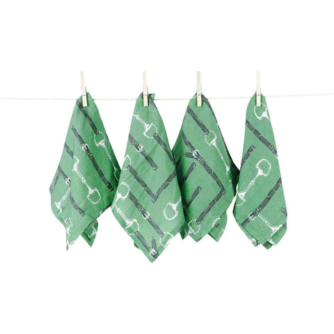Four Medium Green Linen Napkins with White Snaffle Bits and Dark Green Leather on a Clothesline