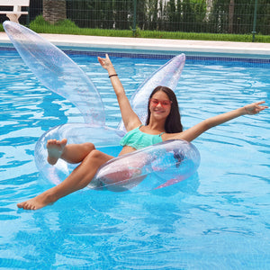 Clear pool float tube with bunny ears, featuring pink glitter inside.