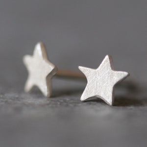 Tiny Star Stud Earrings in Sterling Silver symbols,earrings tiny-star-stud-earrings-in-sterling-silver Default Title