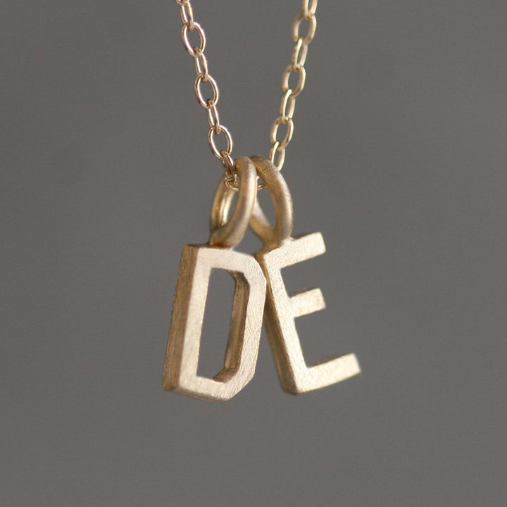 Double block letter initial necklace in 14k gold michelle chang double block letter initial necklace in 14k gold aloadofball Choice Image