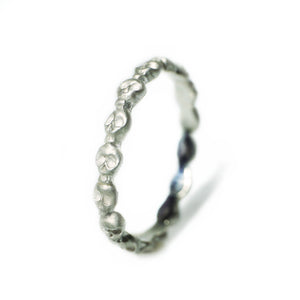 Mini Skull Eternity Band Ring in Sterling Silver