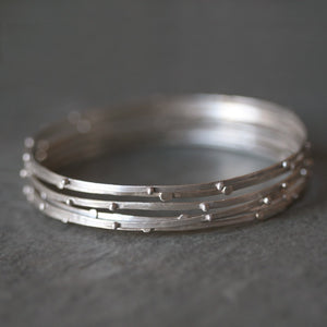 "Stack Bangle in Sterling Silver nature/organic,bracelets stack-bangle-in-sterling-silver 2.5"" Diameter / Beads,2.5"" Diameter / Flat Circles,2.65"" Diameter / Beads,2.65"" Diameter / Flat Circles"