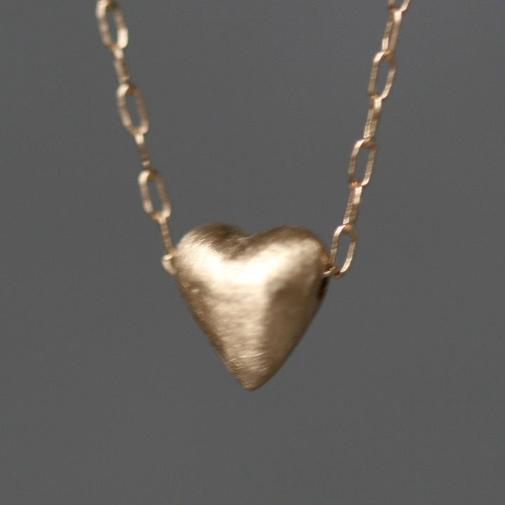 Tiny puffy heart necklace in 14k gold michelle chang tiny puffy heart necklace in 14k gold aloadofball Gallery