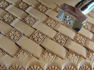The leather stamping tool with the image it creates on vegetable tanned leather
