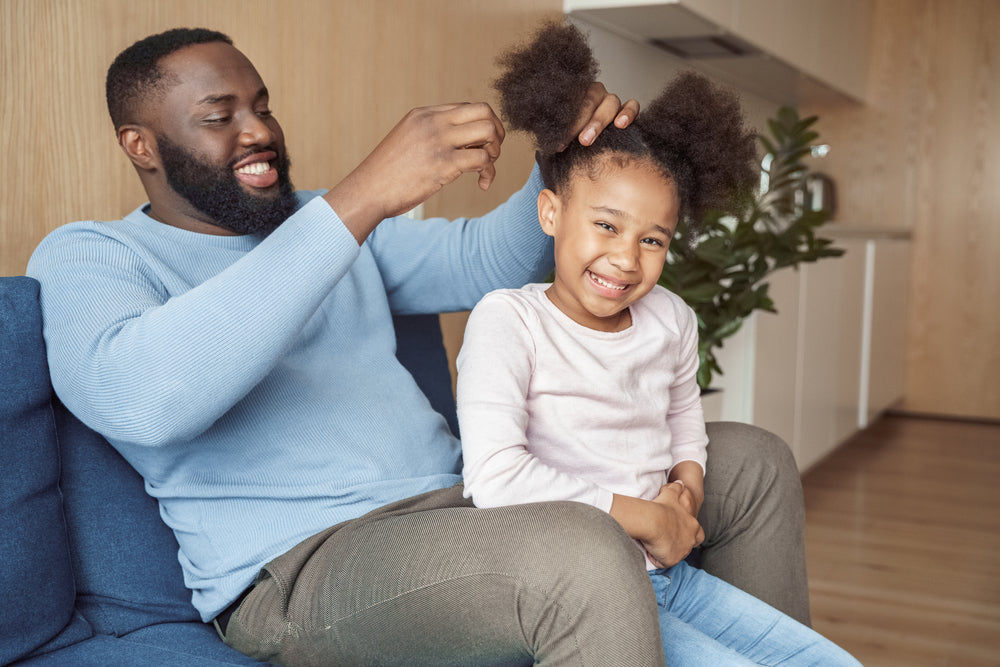Dad putting daughter's hair into afro puffs   curly kids RevAir