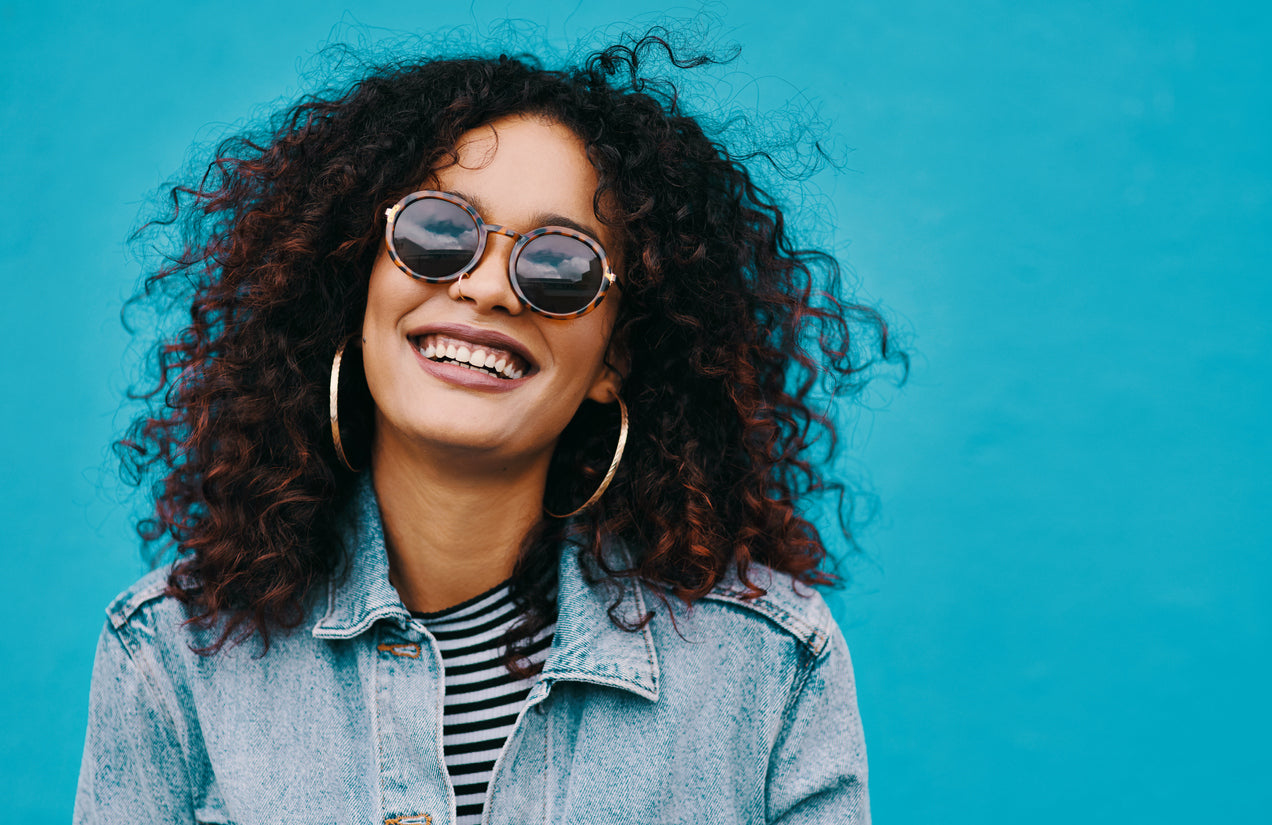 happy black woman with natural curly hair