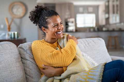 person smiling on couch