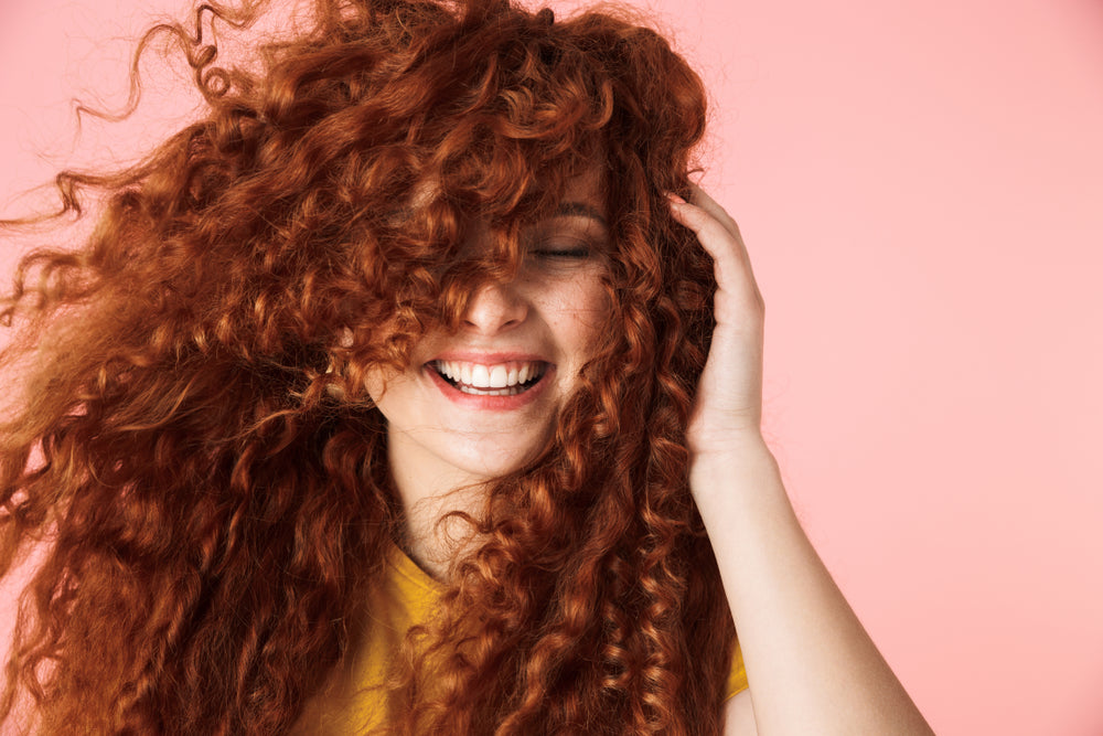 Woman with beautify healthy red curly hair