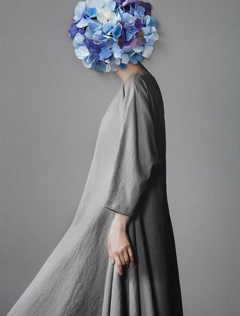 Collage with female portrait and blue flowers