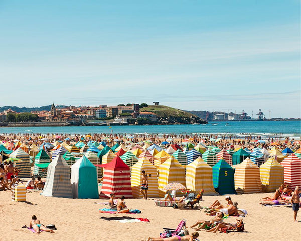 People relaxing on Gijón Beach by Getty Images - FINEPRINT co