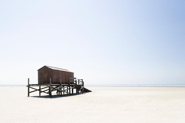 Stilt building on beach by Getty Images - FINEPRINT co