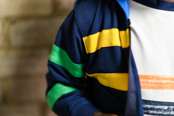 Boy's blue hoodie with yellow and green stripes