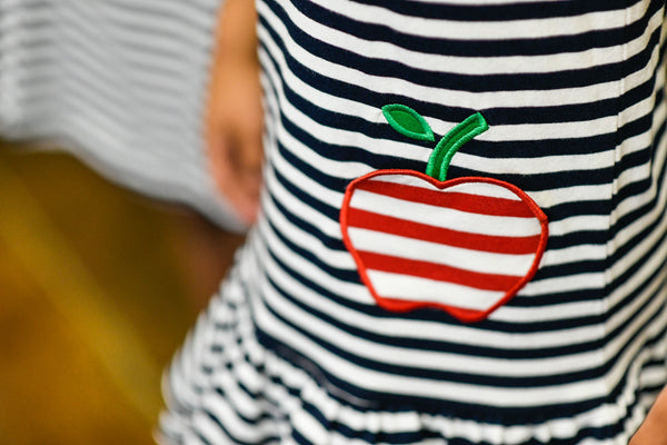 black and white stripe dress with apple decoration