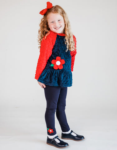 girl wearing a fleece top with flower and matching leggings