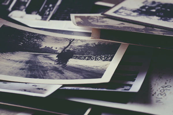 a collection of old family photos to include in a memory book