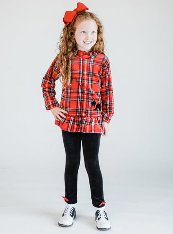 young girl wearing a plaid yorkie fleece top and leggings