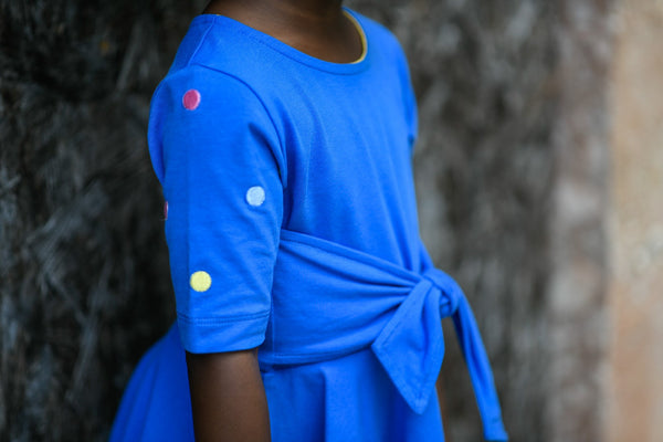 Blue front-tie dress with embroidered polka dots