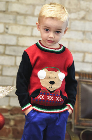 young boy in red bear sweater and blue pants