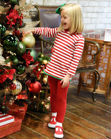young girl in red and white stripe top with flower and matching leggings