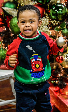 boy in train sweater with bauble
