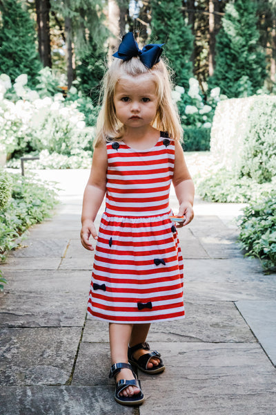 Girls Sundress in Red and White Stripe with Bows on Model