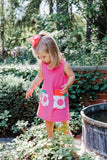Girls Fuchsia Dress with Flower Pockets on Model