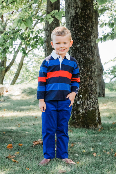 Boys Long Sleeve Polo Shirt in Navy, Blue, and Red on Model