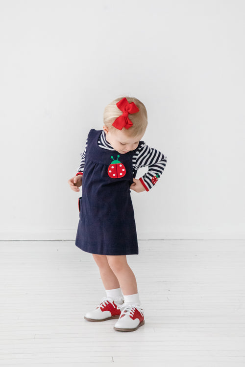 Girls Navy Jumper with Ladybug Appliqués on Model