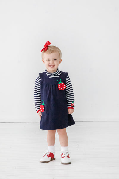Girls Navy and White Striped Shirt with Ladybug on Model