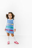Periwinkle Girls Jumper Dress with Bows on Model