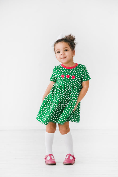 Green Polka Dot Dress with Small Apple Appliqués on Model