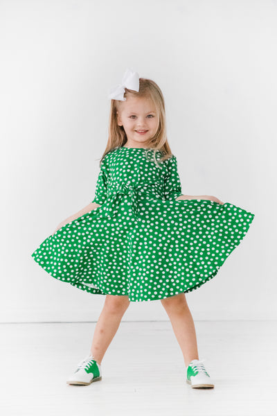 Girls Green Dress in Polka Dot Print with Tie Sash on Model Twirl