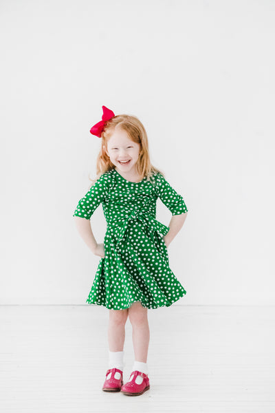 Girls Green Dress in Polka Dot Print with Tie Sash on Model