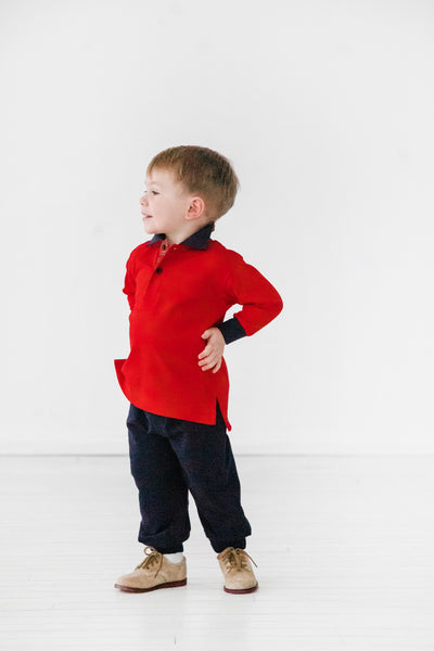 Boys Red Long Sleeve Shirt with Plaid Trim on Model